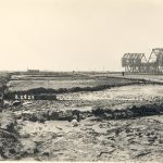 Thumbnail: Dredging and other preparatory work is ongoing for the Ford Motor plant in 1927. The plant opened in 1930. At right is the Badger Avenue Bridge (later the Henry Ford Bridge), a railroad drawbridge across the Cerritos Channel. A more modern version of the bridge is still in place.